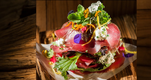 MILLEFOGLIE WITH BRESAOLA, FLAKES OF GOAT CHEESE AND CHIVES, BITTER LETTUCE AND MOUNTAIN FLOWERS