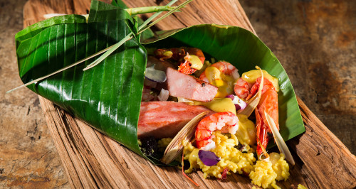 PAPILLOTE OF BANANA TREE LEAF WITH BOLOGNA, PRAWNS, LEMON GRASS AND CURRY RICE