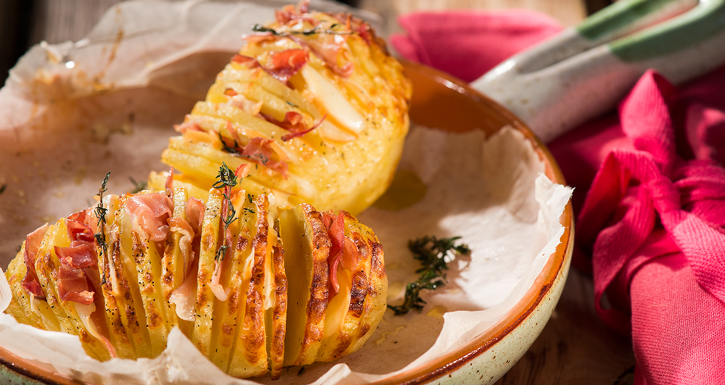 HASSELBACK POTATOES WITH SPECK, SCAMORZA CHEESE AND AROMATIC HERBS